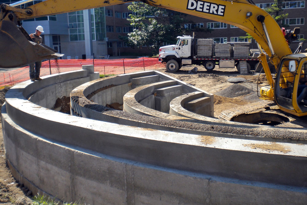 Concrete sidewalks, curbsides, basketbell courts and amphitheatre  and  at MSU Bailey Hall by Moore Trosper Construction